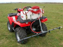 Red ATV with sprayer on back