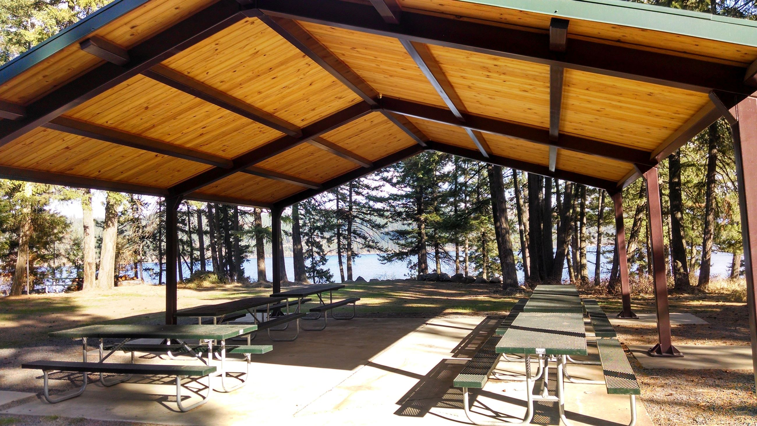 Roofed pavilion with picnic tables