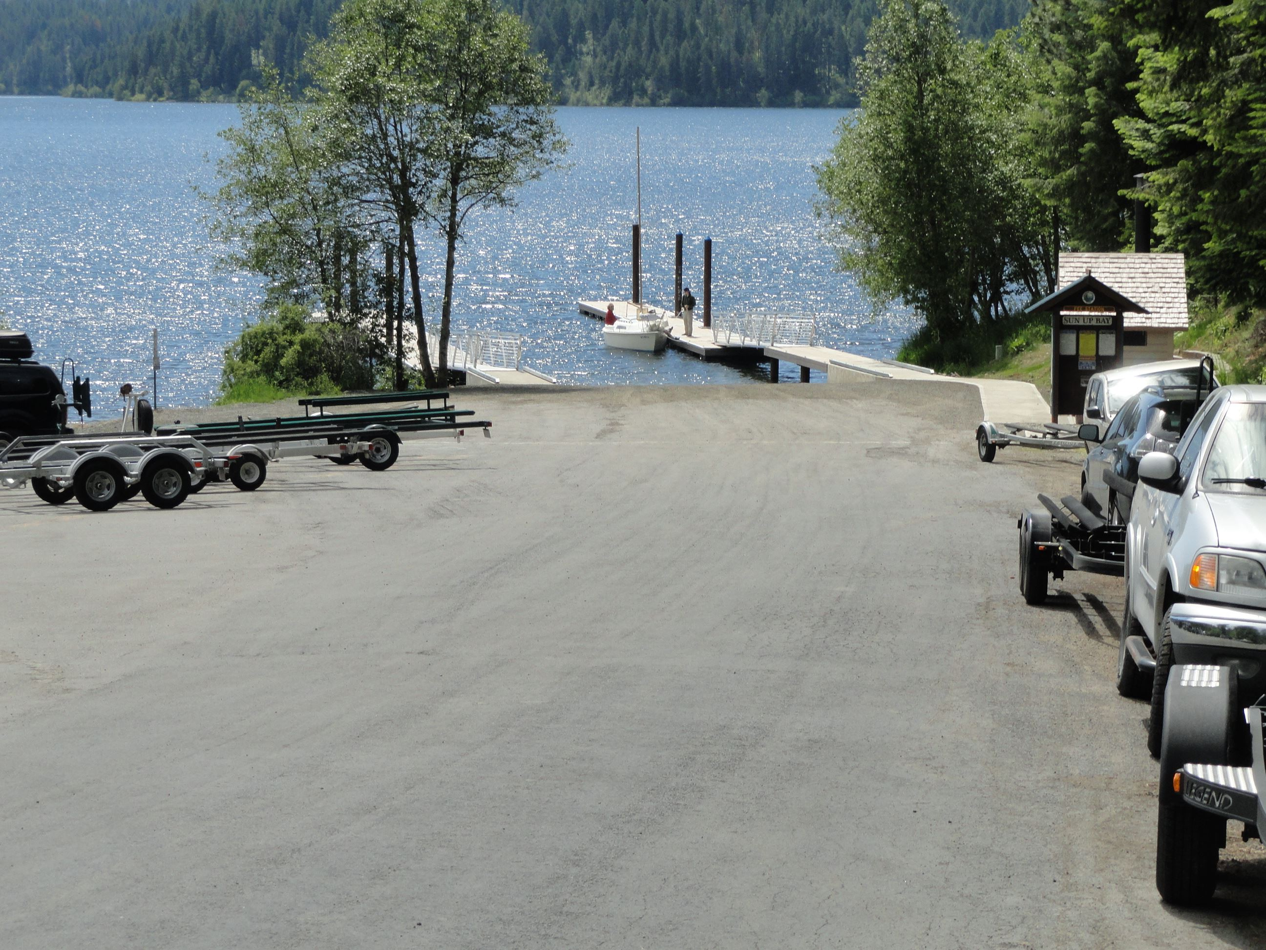 Road leading to lake with dock and launch