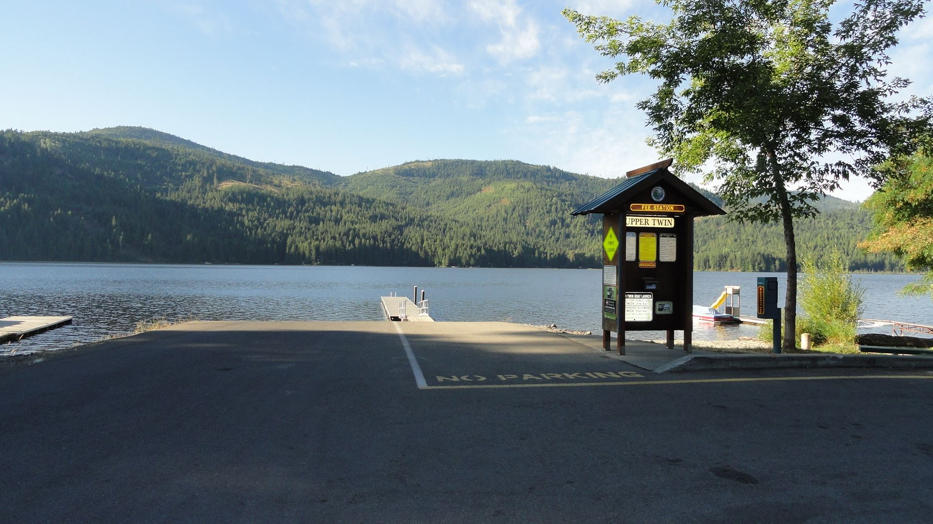Parking lot leading to boat launch at lake