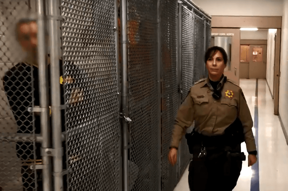 Deputy next to cages closeup